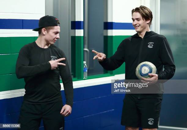 Troy Stecher and Jake Virtanen of the Vancouver Canucks play rockpaperscissors as they warmup before their NHL game against the Carolina Hurricanes...