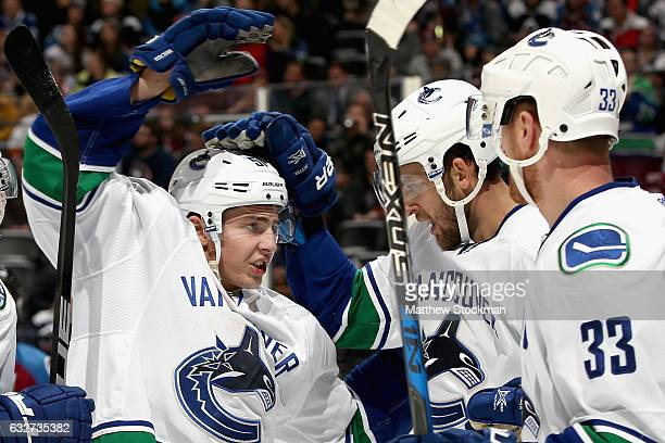 Troy Stecher of the Vancouver Canucks celebrates with Daniel Sedin and Henrik Sedin the go ahead goal in the third period against the Colorado...