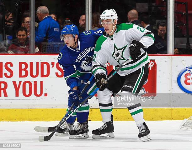 Troy Stecher of the Vancouver Canucks checks Adam Cracknell of the Dallas Stars during the NHL game at Rogers Arena November 13 2016 in Vancouver...