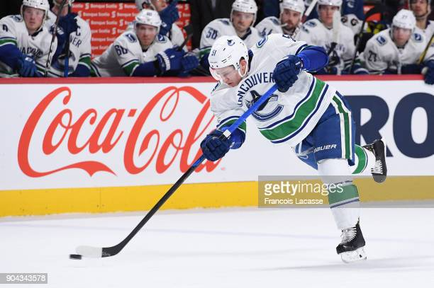 Troy Stecher of the Vancouver Canucks fires a slap shot against the Montreal Canadiens in the NHL game at the Bell Centre on January 7 2018 in...