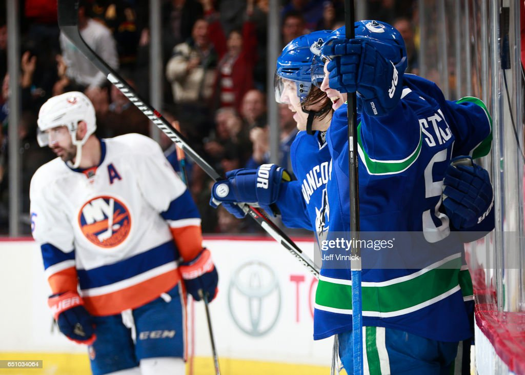 Troy Stecher #51 of the Vancouver Canucks is congratulated by teammate Markus Granlund #60 after scoring on the New York Islanders during their NHL game at Rogers Arena March 9, 2017 in Vancouver, British Columbia, Canada. New York won 4-3 in overtime.