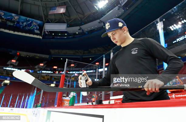 Troy Stecher of the Vancouver Canucks paints his game stick before their NHL game at Rogers Arena March13 2017 in Vancouver British Columbia Canada
