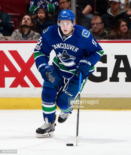 Troy Stecher of the Vancouver Canucks skates up ice with the puck during their NHL game against the New York Islanders at Rogers Arena March 9 2017...