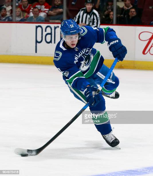 Troy Stecher of the Vancouver Canucks skates up ice with the puck during their NHL game against the Philadelphia Flyers at Rogers Arena December 7...