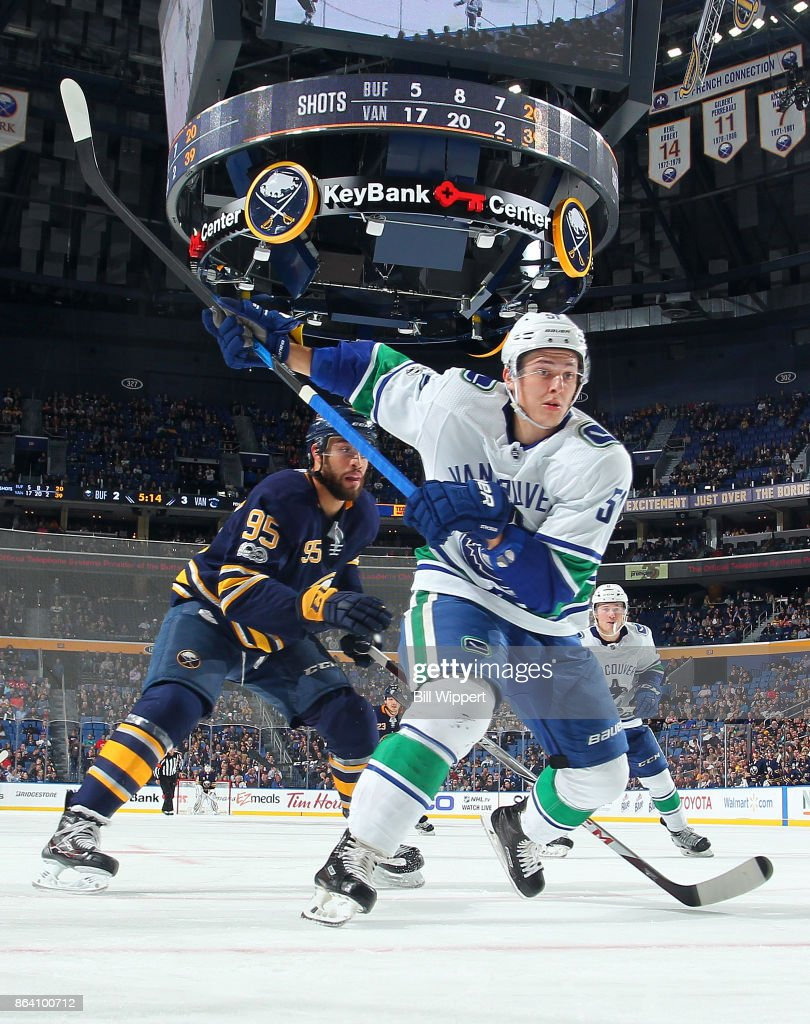 Troy Stecher #51 of the Vancouver Canucks winds up to clear the puck against Justin Bailey #95 of the Buffalo Sabres during an NHL game on October 20, 2017 at KeyBank Center in Buffalo, New York.Vancouver won, 4-2.