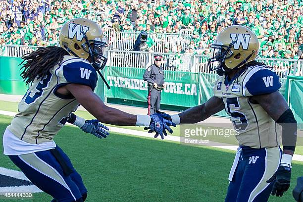 Troy Stoudermire and Don Unamba of the Winnipeg Blue Bombers celebrate after a touchdown in a game between the Winnipeg Blue Bombers and Saskatchewan...