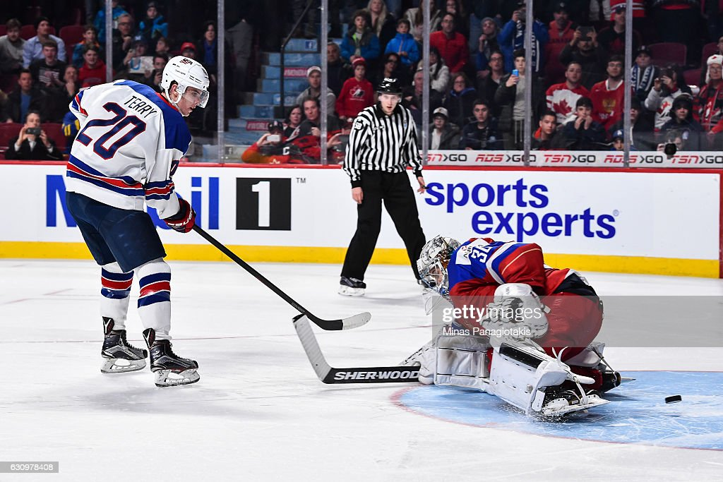 Troy Terry #20 of Team United States gets the puck past goaltender Ilya Samsonov #30 of Team Russia in a shootout to score the game winning goal during the 2017 IIHF World Junior Championship semifinal game against Team Russia at the Bell Centre on January 4, 2017 in Montreal, Quebec, Canada. The Team United States defeated Team Russia 4-3 in a shootout.