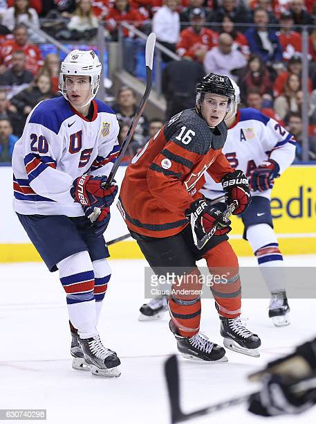 Troy Terry of Team USA skates against Taylor Raddysh of Team Canada during a preliminary round game in the 2017 IIHF World Junior Hockey Championship...