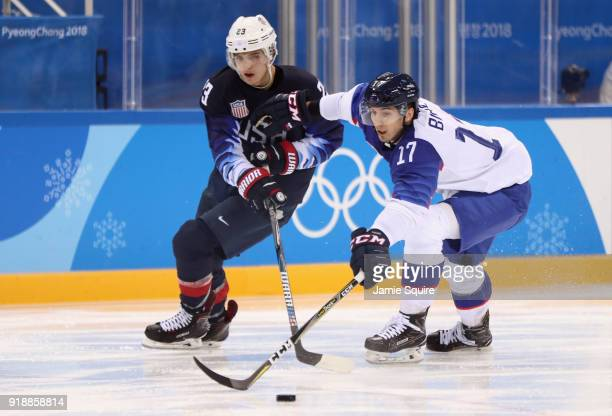 Troy Terry of the United States and Milos Bubela of Slovakia go for the puck during the Men's Ice Hockey Preliminary Round Group B game at Gangneung...