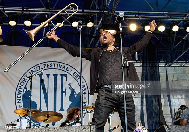 Troy Trombone Shorty Andrews and Orleans Avenue perform during the 2014 Newport Jazz Festival at Fort Adams State Park on August 1 2014 in Newport...
