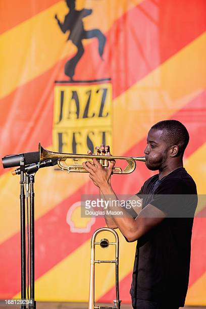 """Troy """"Trombone Shorty"""" Andrews and Orleans Avenue performs during the 2013 New Orleans Jazz & Heritage Music Festival at Fair Grounds Race Course on..."""