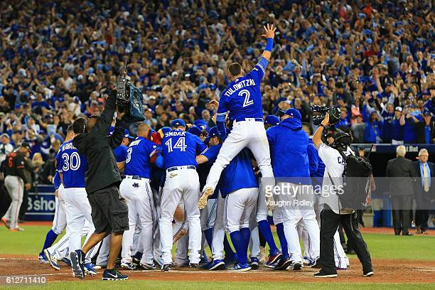 Troy Tulowitzki and the Toronto Blue Jays celebrate defeating the Baltimore Orioles 52 to win the American League Wild Card game at Rogers Centre on...