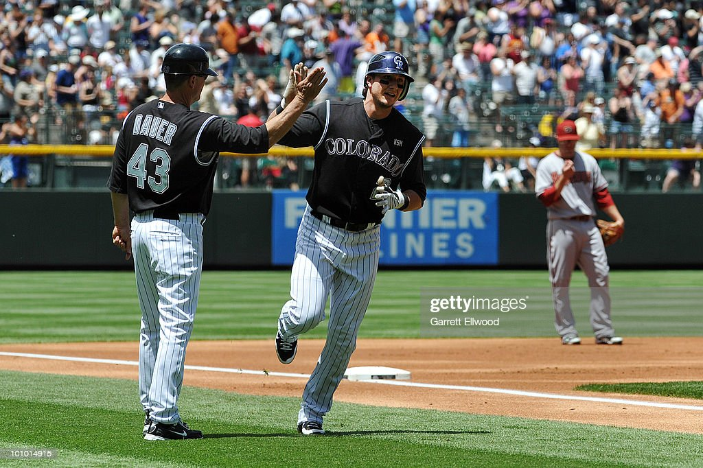 Troy Tulowitzki #2 celebrates his home run with third base coach Rich Dauer #43 of the Colorado Rockies during the game against the Arizona Diamondbacks at Coors Field on May 27, 2010 in Denver, Colorado.