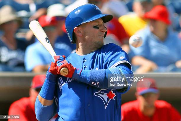 Troy Tulowitzki of the Blue Jays backs away from a high and inside pitch during the spring training game between the Toronto Blue Jays and the...