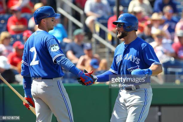 Troy Tulowitzki of the Blue Jays congratulates Kevin Pillar for scoring a run during the spring training game between the Toronto Blue Jays and the...