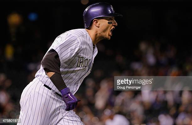 Troy Tulowitzki of the Colorado Rockies celebrates as he rounds the bases on his three run home run off of Mike Bolsinger of the Los Angeles Dodgers...