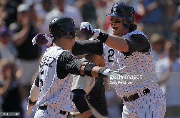 Troy Tulowitzki of the Colorado Rockies celebrates his two run home run with Carlos Gonzalez who scored on the play as the Rockies took a 51 lead...