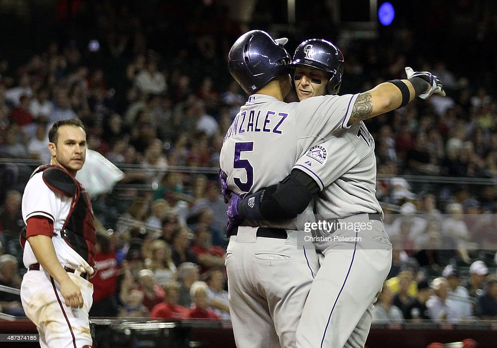 Troy Tulowitzki #2 of the Colorado Rockies celebrates with Carlos Gonzalez #5 after Tulowitzki hit a two-run home run against the Arizona Diamondbacks during the sixth inning of the MLB game at Chase Field on April 29, 2014 in Phoenix, Arizona.