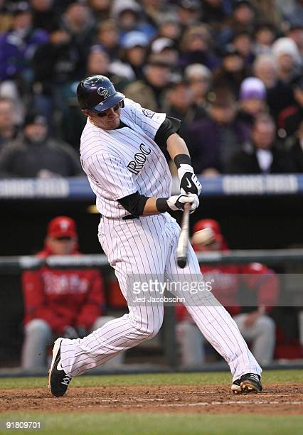 Troy Tulowitzki of the Colorado Rockies hits a RBI double against the Philadelphia Phillies in the bottom of the sixth inning in Game Four of the...