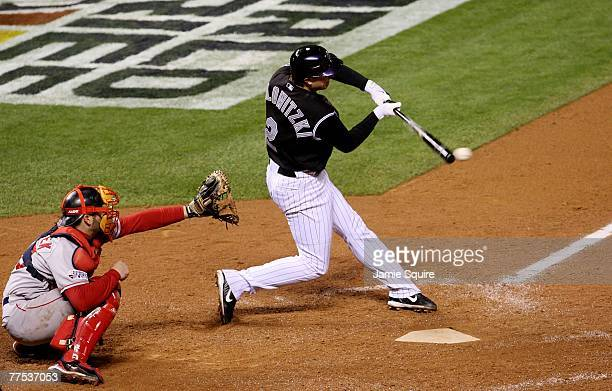 Troy Tulowitzki of the Colorado Rockies hits a single in the bottom of the seventh inning against the Boston Red Sox during Game Three of the 2007...