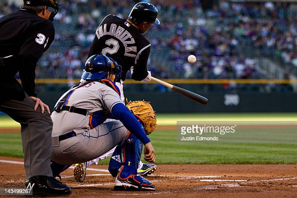 Troy Tulowitzki of the Colorado Rockies hits a solo home run during the first inning against the New York Mets at Coors Field on April 27 2012 in...