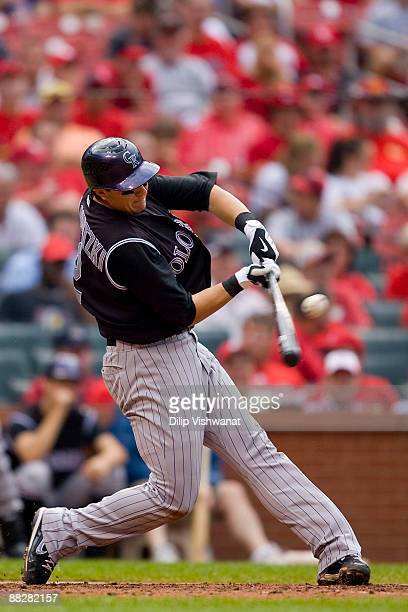 Troy Tulowitzki of the Colorado Rockies hits an RBI single against the St. Louis Cardinals on June 7, 2009 at Busch Stadium in St. Louis, Missouri....