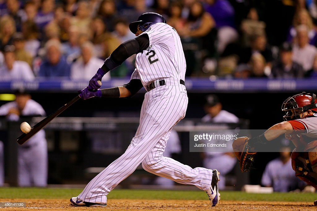 Troy Tulowitzki #2 of the Colorado Rockies hits his 16th home run of the year during the sixth inning against the Arizona Diamondbacks at Coors Field on June 5, 2014 in Denver, Colorado.