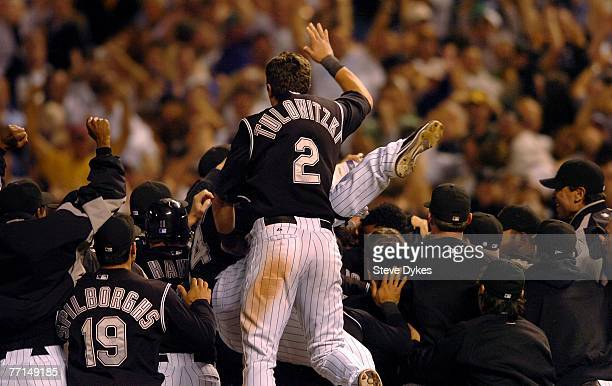 Troy Tulowitzki of the Colorado Rockies jumps into the pile as he celebrates his teams wild card playoff baseball victory over the San Diego Padres...