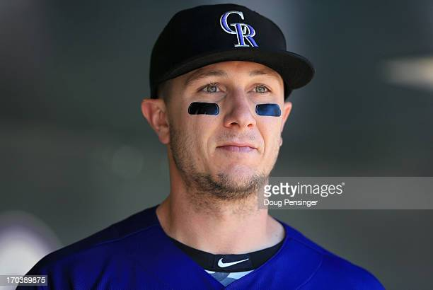Troy Tulowitzki of the Colorado Rockies looks on from the dugout against the San Diego Padres at Coors Field on June 9 2013 in Denver Colorado The...
