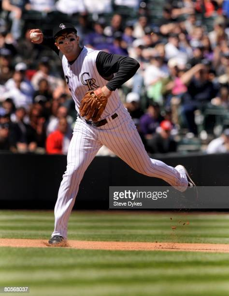 Troy Tulowitzki of the Colorado Rockies makes a play on a ball during the MLB game against the Arizona Diamondbacks at Coors Field on April 6 2008 in...