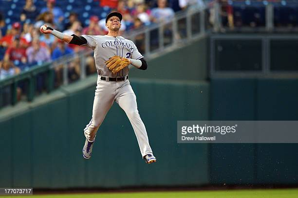 Troy Tulowitzki of the Colorado Rockies makes a throw to first base in the second inning against the Philadelphia Phillies at Citizens Bank Park on...