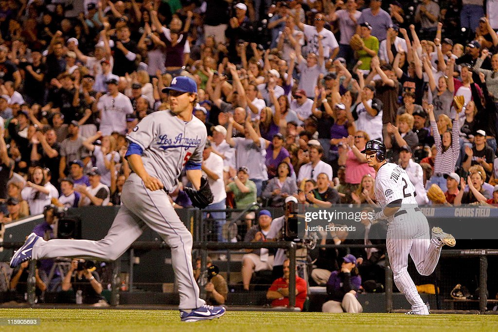Troy Tulowitzki #2 of the Colorado Rockies prepares to round first base after hitting a single to left field to drive in two runs off of relief pitcher Matt Guerrier #55 of the Los Angeles Dodgers during the eighth inning at Coors Field on June 11, 2011 in Denver, Colorado.