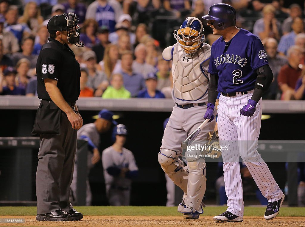 Troy Tulowitzki #2 of the Colorado Rockies protests a called third strike with umpire Chris Guccione as catcher Yasmani Grandal #9 of the Los Angeles Dodgers looks on during game two of a double header at Coors Field on June 2, 2015 in Denver, Colorado.