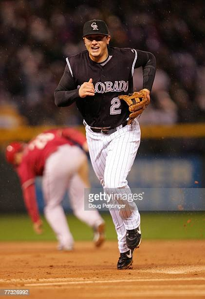 Troy Tulowitzki of the Colorado Rockies runs to the dugout after he turned an inning ending double play in the top of the second inning on a ball hit...