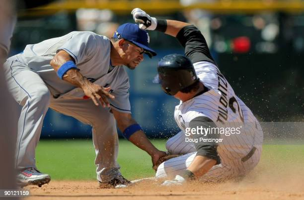 Troy Tulowitzki of the Colorado Rockies steals second base ahead of the tag by shortstop Rafael Furcal of the Los Angeles Dodgers in the sixth inning...