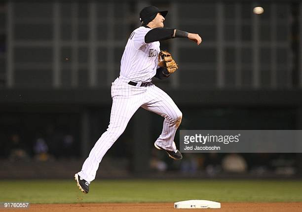 Troy Tulowitzki of the Colorado Rockies throws out Shane Victorino of the Philadelphia Phillies in the seventh inning in Game Three of the NLDS...