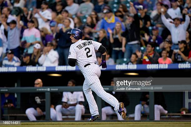 Troy Tulowitzki of the Colorado Rockies trots around the bases after hitting a solo home run during the third inning against the Arizona Diamondbacks...