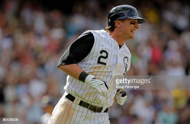 Troy Tulowitzki of the Colorado Rockies winces as he heads for first on his RBI single that scored Eric Young Jr. To tie the game 3-3 in the seventh...