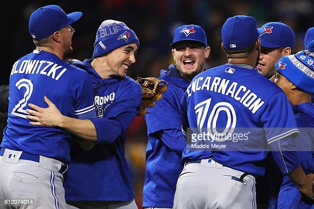 Troy Tulowitzki of the Toronto Blue Jays Aaron Sanchez and Edwin Encarnacion celebrate their 21 win over the Boston Red Sox clinching a Wildcard spot...