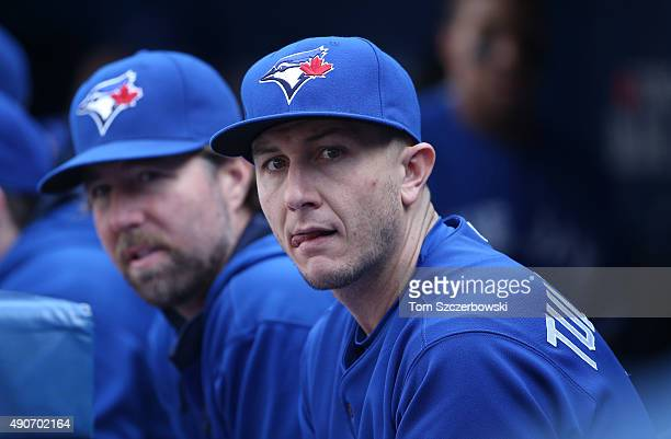 Troy Tulowitzki of the Toronto Blue Jays and RA Dickey look on from the top step of the dugout during MLB game action against the Tampa Bay Rays on...