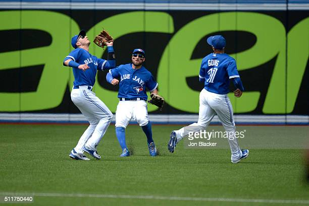 Troy Tulowitzki of the Toronto Blue Jays catches a popup in front of teammates Kevin Pillar and Ryan Goins during the game against the Minnesota...