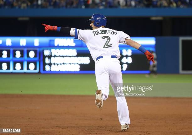 Troy Tulowitzki of the Toronto Blue Jays celebrates as he circles the bases on his grand slam home run in the third inning during MLB game action...