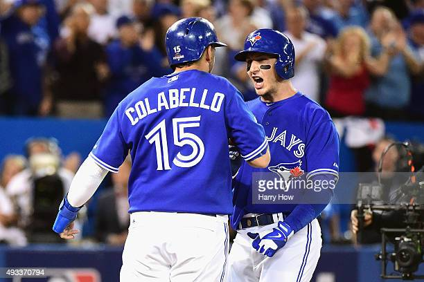 Troy Tulowitzki of the Toronto Blue Jays celebrates with Chris Colabello of the Toronto Blue Jays after hitting a threerun home run in the third...