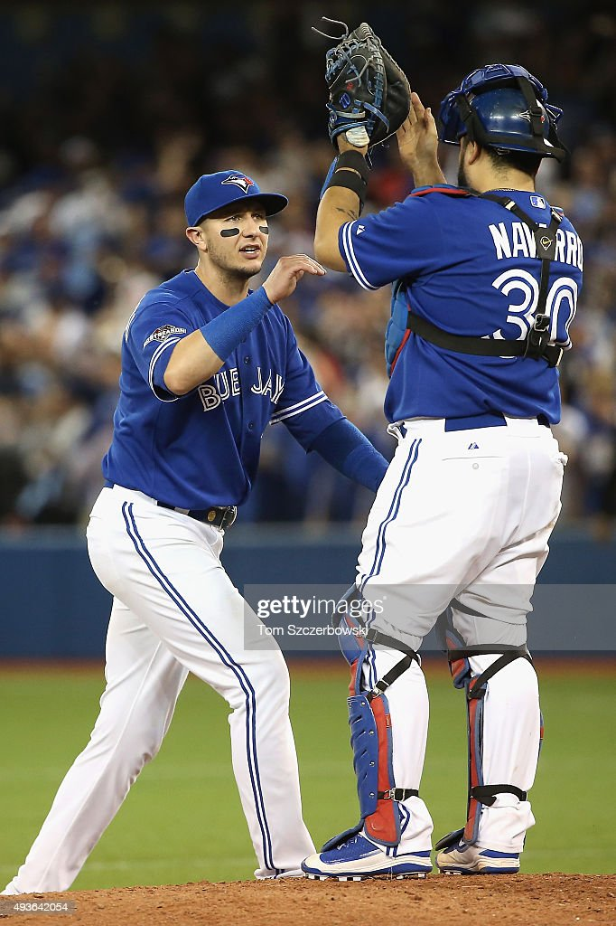Troy Tulowitzki #2 of the Toronto Blue Jays celebrates with Dioner Navarro #30 of the Toronto Blue Jays after defeating the Kansas City Royals 7-1 in game five of the American League Championship Series at Rogers Centre on October 21, 2015 in Toronto, Canada.