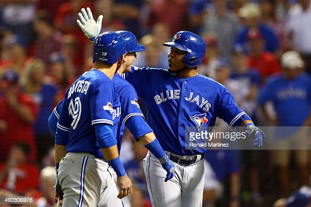 Troy Tulowitzki of the Toronto Blue Jays celebrates with Edwin Encarnacion and Jose Bautista after hitting a three run home run against Chi Chi...