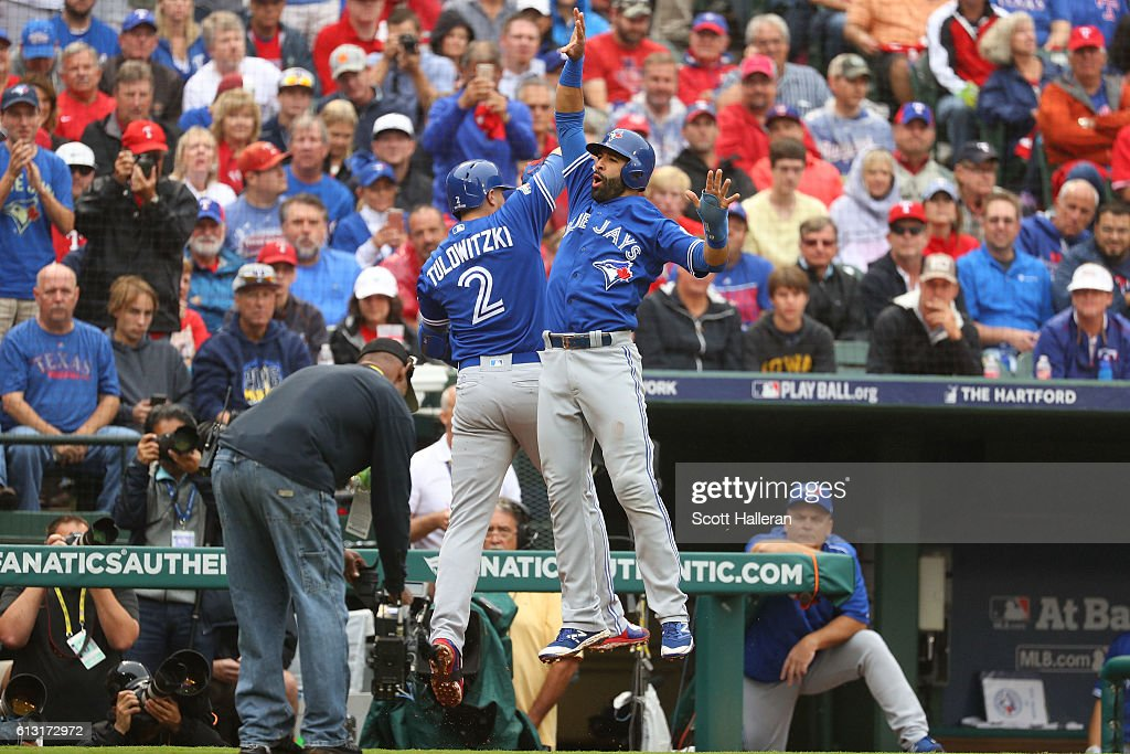 Troy Tulowitzki #2 of the Toronto Blue Jays celebrates with Jose Bautista #19 after hitting a home run against the Texas Rangers in the second inning of game two of the American League Divison Series at Globe Life Park in Arlington on October 7, 2016 in Arlington, Texas.