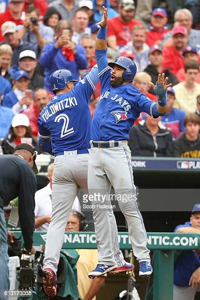 Troy Tulowitzki of the Toronto Blue Jays celebrates with Jose Bautista after hitting a home run against the Texas Rangers in the second inning of...
