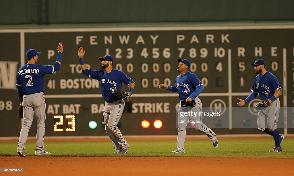 Troy Tulowitzki #2 of the Toronto Blue Jays celebrates with Jose Bautista #19, Kevin Pillar #11 and Ben Revere #7 after defeating the Boston Red Sox 5-1 at Fenway Park on September 8, 2015 in Boston, Massachusetts.