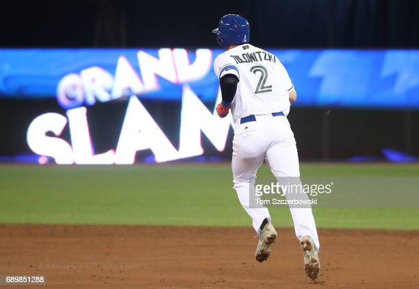 Troy Tulowitzki of the Toronto Blue Jays circles the bases on his grand slam home run in the third inning during MLB game action against the...
