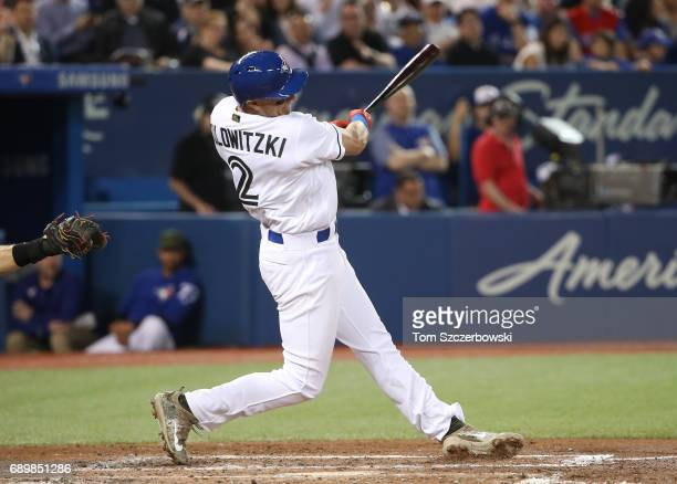 Troy Tulowitzki of the Toronto Blue Jays hits a grand slam home run in the third inning during MLB game action against the Cincinnati Reds at Rogers...